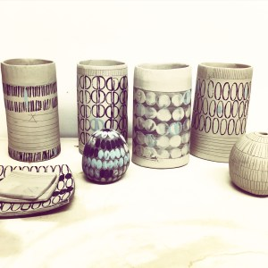 hand built clay pots decorated with slip inlay and stamps