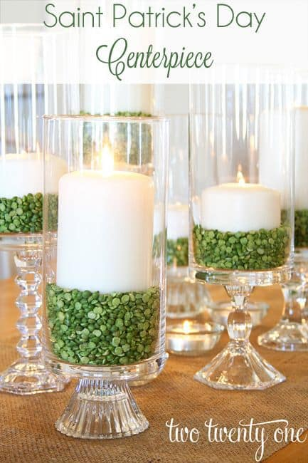 hurricane candles with green split peas, DIY St. Patrick's Day centerpiece