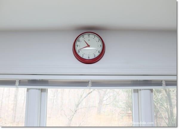 red clock in farmhouse kitchen