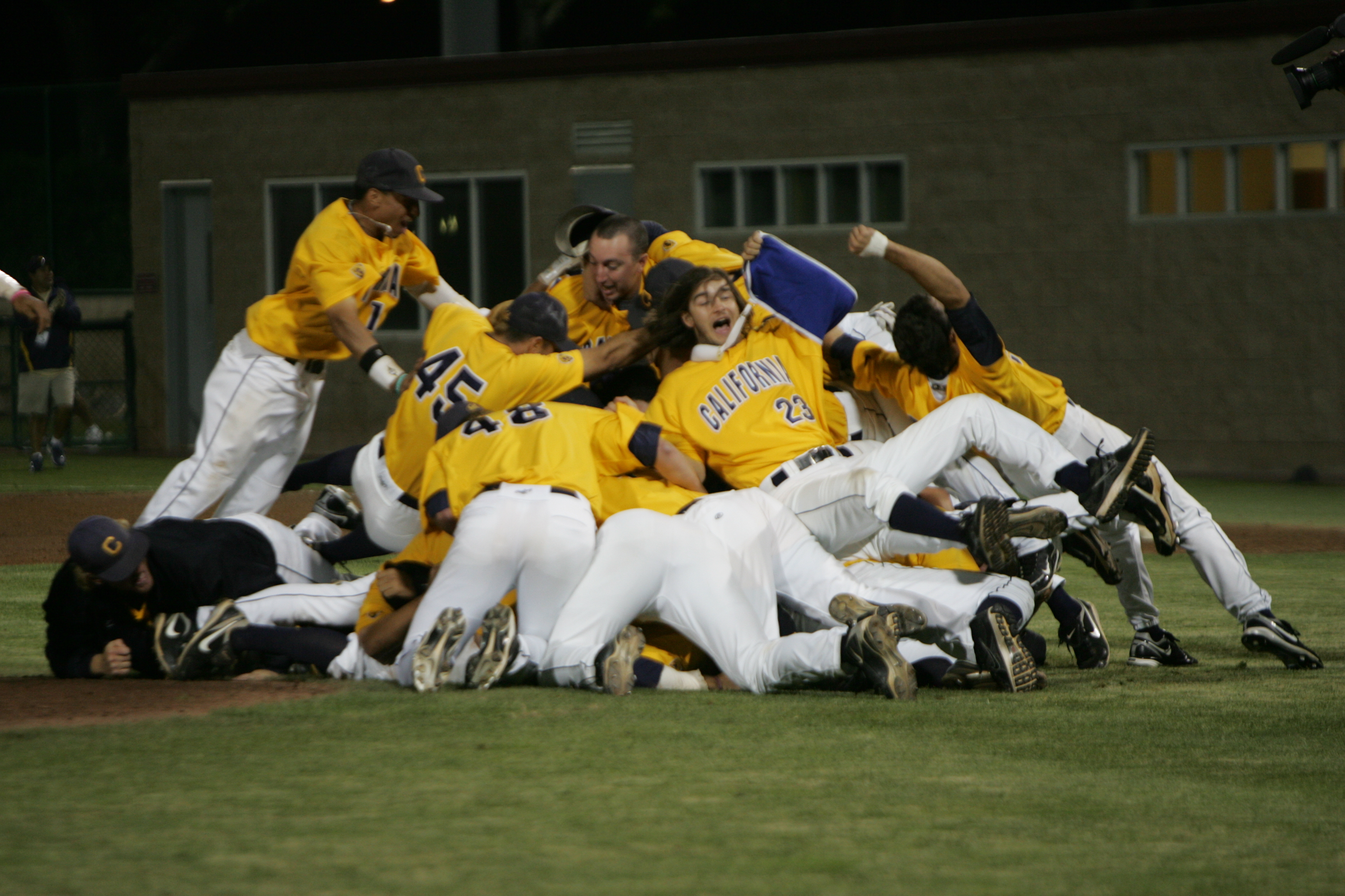 The Cal baseball team celebrates after sweeping Dallas Baptist to earn a trip to the College World Series in Omaha, Neb.