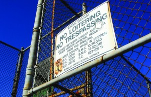 Signs prohibiting loitering and trespassing are found on fences and doors around the Berkeley High School campus. Recent incidences of bringing guns on campus have prompted a committee to work on safety recommendations.