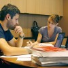 Despite fee hikes, UC Berkeley and UCLA law students will pay the same as Boalt graduates Joe Rose and Sara Giardina, seen here studying for the bar exam, due to scholarships.