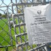 A notice posted by the Berkeley Unified School District on the fence around Derby Field.