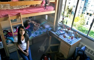 Freshman Ashmita Baral sitting in her dorm room in Unit 2.