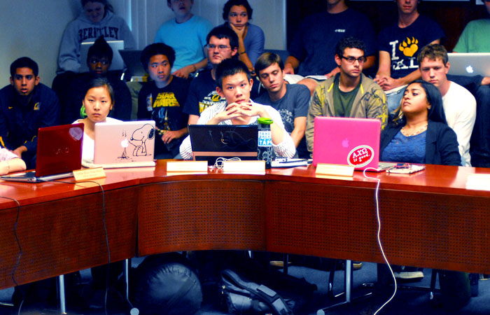 ASUC senators and members of the Berkeley College Republicans sit in the ASUC Senate Chambers on Sunday night during the emergency senate meeting.