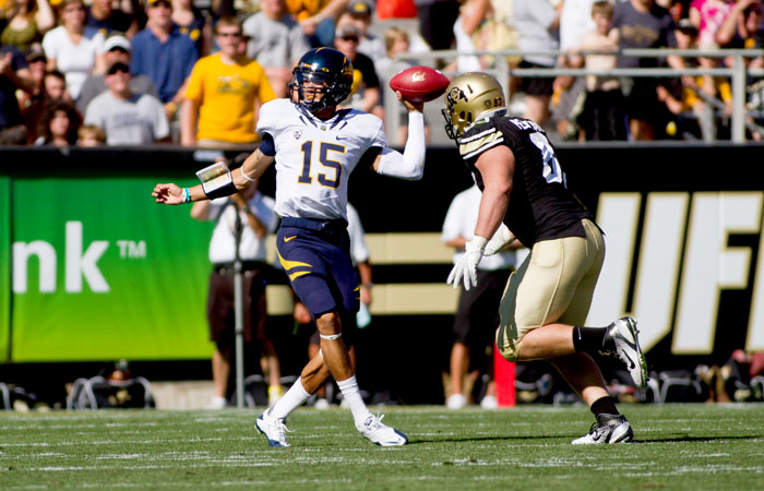 Cal quarterback Zach Maynard threw a touchdown pass to his half-brother Keenan Allen in overtime to win Saturday's game against Colorado.