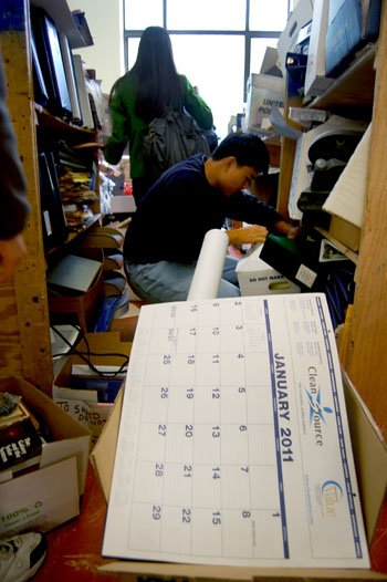 Raymond Ma, a first-year undergraduate, rummages through free items in Campbell Hall. Campbell Hall is scheduled to be demolished due to seismic concerns.