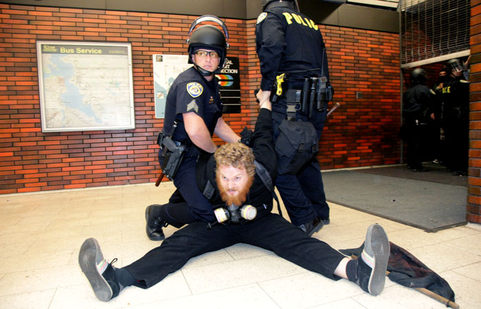 An Occupy Oakland protester was arrested at the 12th Street BART Station in Oakland.