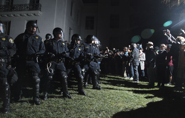 Police line up outside Sproul Hall in riot gear.