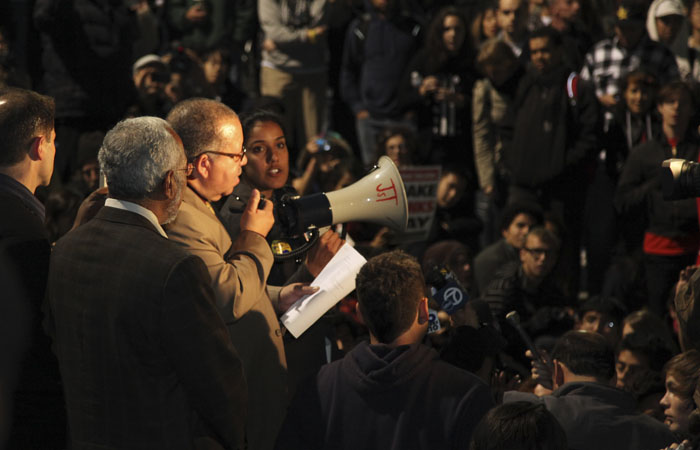 UC Berkeley Vice Chancellor Harry Le Grande speaks to the protesters on Sproul Plaza.