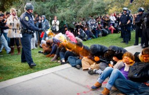 Lt. John Pike uses pepper spray on demonstrators protesting at UC Davis.