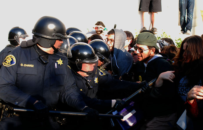 Police attempt to break through a line of students on Nov. 9 during the Occupy Cal protests.