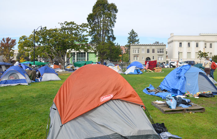 Tents set up by members of Occupy Berkeley dot the grass at Martin Luther King Park in Downtown Berkeley.