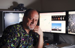 UC Berkeley professor Geoff Marcy sits in front of terminals that allow for remote control of the W. M. Keck Observatory, located near the summit of a Hawaiian volcano.