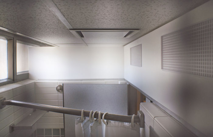 After peeping incidents in the residence halls, panels were installed in the bathrooms.