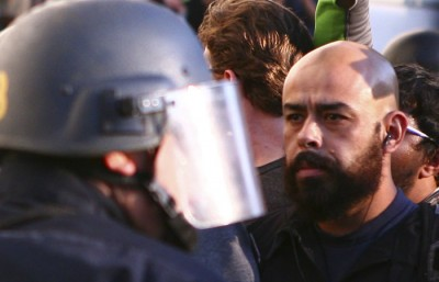Juan Davalos, seen here during the November 9th protests, has had his protest-related charges dropped after Chancellor Birgeneau withdrew his support.