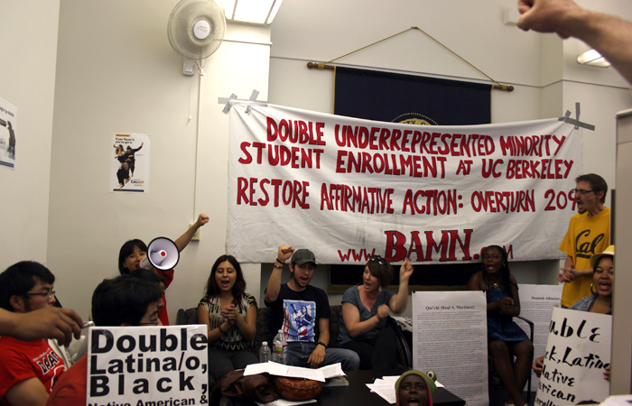 Yvette Felarca (in red shirt), BAMN organizer, protested at the UC office of undergraduate admissions on Friday with minority students who were not admitted to UC Berkeley and filed appeals. The protesters wanted UCB to double the number of minority students accepted.