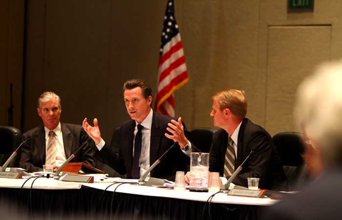 "Lt. Gov. Gavin Newsom addressed the regents, urging them to ""critically analyze the mission and the broader challenges of the system."""
