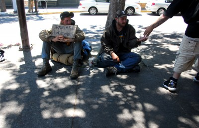 Keelan (left) and Robbie (right) met a week and a half ago in Berkeley. The two spend Sunday panhandling in the hopes of getting enough money for a bart ticket to Richmond.