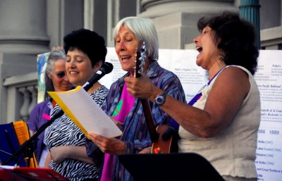 "The ""Occupella"" group performs during a rally on the steps of city hall in opposition to Citizens United."