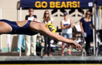 Dana Vollmer, who finished her Cal career in 2009, won a gold and set a world record in the 100 fly Sunday.