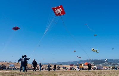 Members from San Francisco Bay Area International Association of Tako Age (IATA) reel in one of their enormous Hamamatsu kites at the Berkeley Kite Festival, this year.