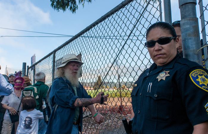 Protestors, attempting to harvest crops, were originally unable to enter the Gill Tract due to a locked gate and the police. They later entered through another entrance.