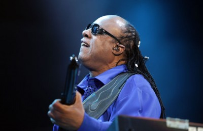 Stevie Wonder plays the keytar at the Main Stage Sunday night. (Gracie Malley/Staff)