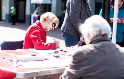 A woman registers to vote in Downtown Berkeley. September 25th marked the first National Voter Registration Day.