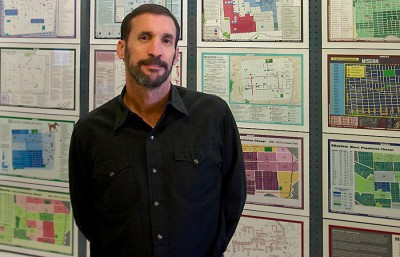 Cartographer and UC Berkeley lecturer Darin Jensen stands in front of maps created by students based on the Mission neighborhood in San Francisco.