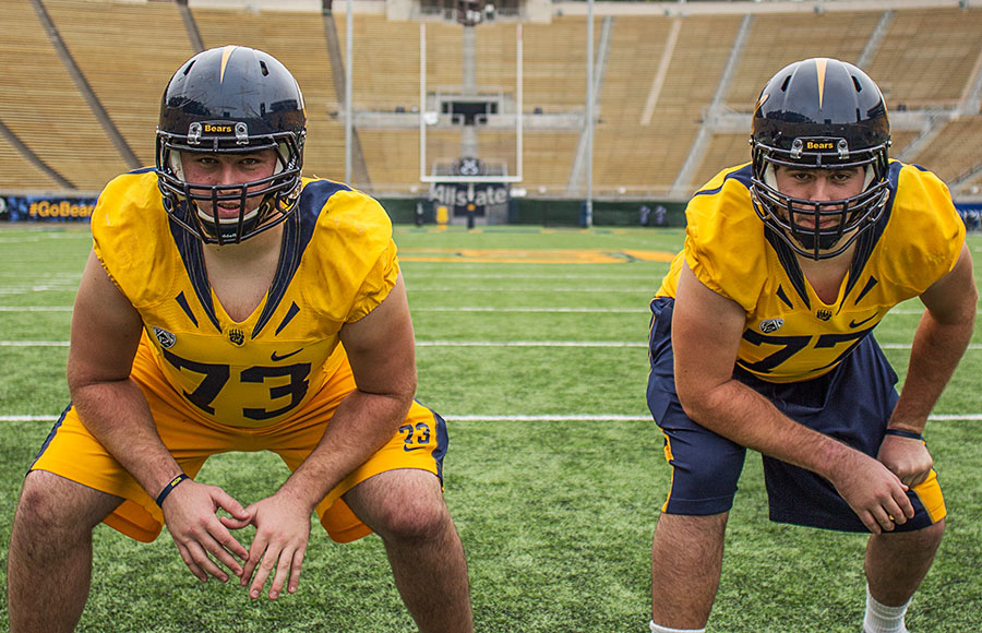 Brother Jordan, left, and Tyler Rigsbee make up two-fifths of the offensive line. Tyler, a redshirt senior, helped teach the playbook to Jordan, a redshirt freshman.