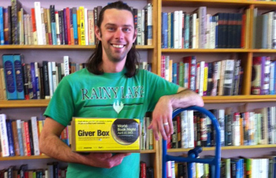 Nathan Embretson holds a box for World Book Night at Pegasus Books in Berkeley. The event aims to spread literacy among nonreaders.