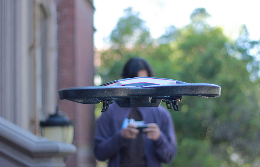 A student-programmed drone flies near the School of Information. A team hopes to make drones widely usable.