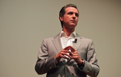 Gavin Newsom speaks to Political Science 179 students about his new book on Wednesday evening in Wheeler Auditorium.