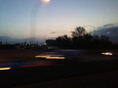 Los Angeles Freeway at 5 A.M. through Greyhound bus window