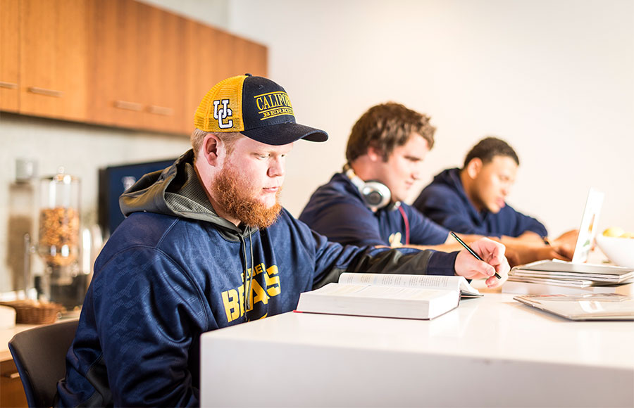 Cal football players have to balance the rigorous workload of playing football and keeping their GPA afloat.