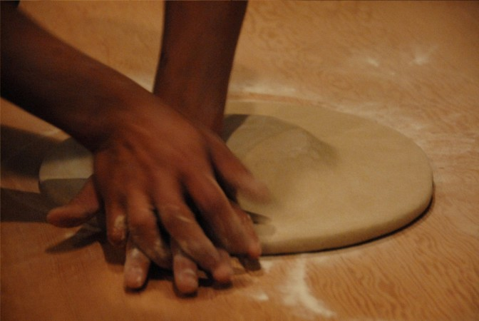 The soba dough has all the water necessary. Ishii sculpts the brick of dough into a disk.
