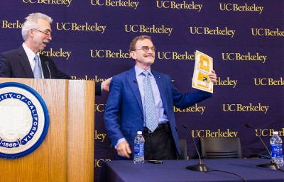 Randy Schekman of the campus department of molecular and cell  biology accepts his Nobel laureate parking pass while Dirks looks on.