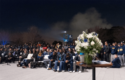 Student-athletes and members of his fraternity, Omega Psi Phi, led an evening candlelight service Feb. 12 outside Memorial Stadium.