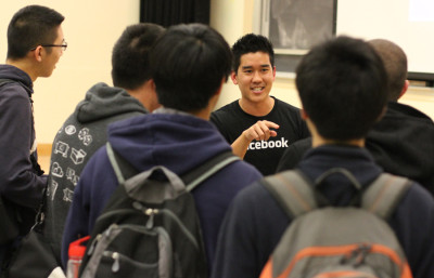 A Facebook recruiter is surrounded by UC Berkeley students eager to join the tech industry primarily clustered around Silicon Valley.