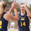 Maddy Kerr (left) and Nikki Gombar (right) celebrate during Cal's match against UOP.