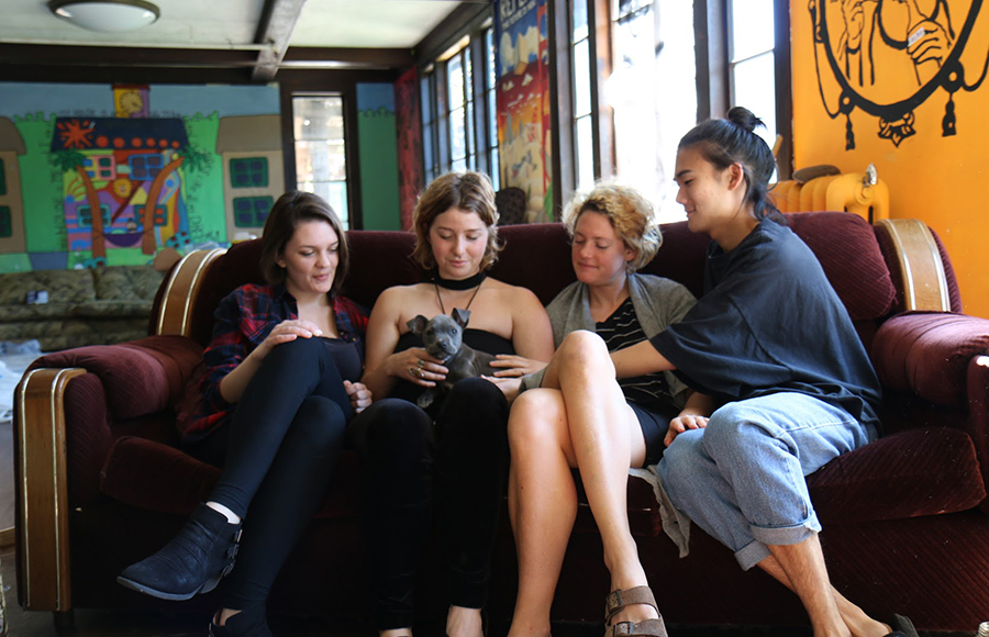 Captain (house manager) Shannon Levis, Natasha Von Kaenel, Elizabeth Calhoun and Justin Hsiung sit in Cloyne Court the day before the Berkeley Student Cooperative voted to convert the co-op into substance-free housing.