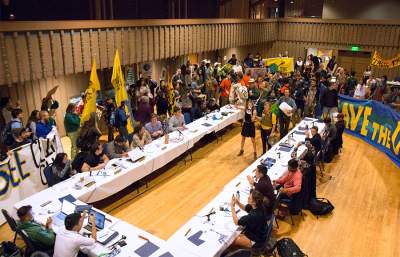 Students and community members involved with Fossil Free Cal rallied at the ASUC Senate meeting Wednesday evening.
