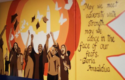 The Haas Dreamers Resource Center in the Cesar Chavez Student Center, which houses the Undocumented Student Program, features a mural depicting educational opportunities for underrepresented minorities.