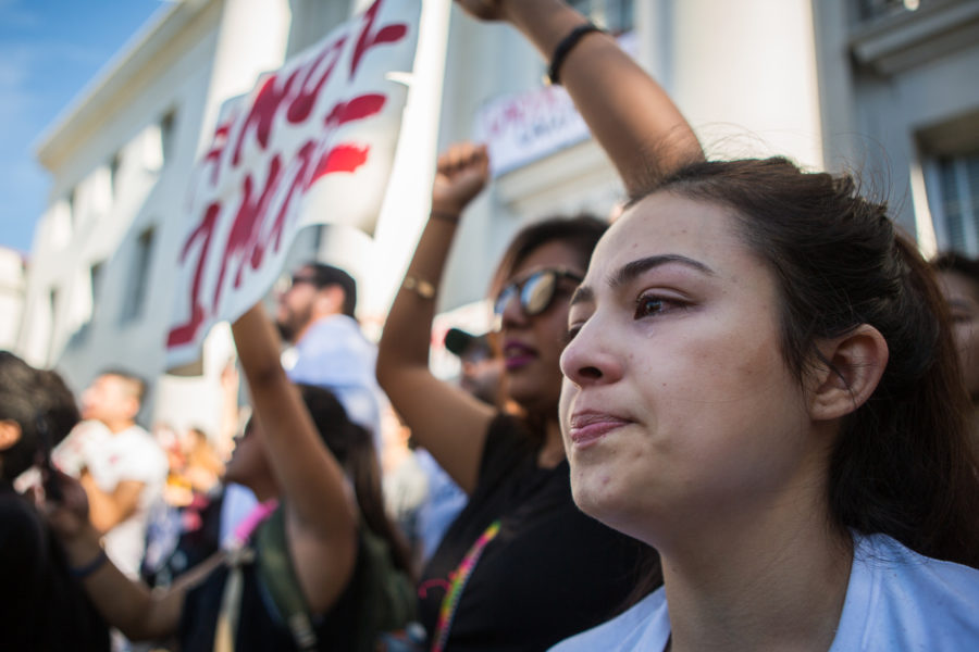 UC Berkeley senior Ciclady Rodriguez sheds a tear while chanting in support of UC Berkeley's undocumented students at a protest held in front of UC Berkeley's Sproul Hall on Wednesday, November 9, 2016 in Berkeley, Calif. (Rachael Garner/Senior Staff)