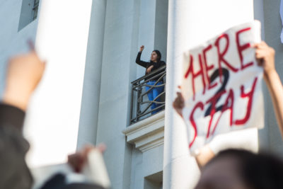 A protester chants in support of UC Berkeley's undocumented students from a balcony of UC Berkeley's Sproul Hall on Wednesday, November 9, 2016 in Berkeley, Calif. (Rachael Garner/Senior Staff)