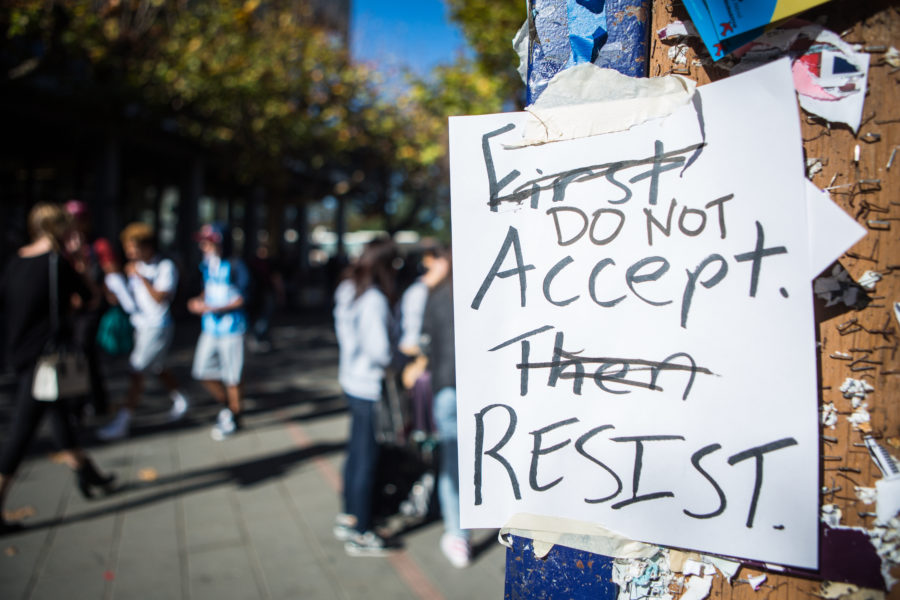 "Signs across campus asking students to ""First accept, then Resist"" were vandalized to convey ""Do not accept, resist."" Protests continued throughout campus on Wednesday,  November 9, 2016 in Berkeley, Calif. (Rachael Garner/Senior Staff)"