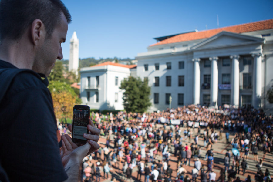 A bystander livestreams the growing anti-Trump protest on UC Berkeley's Sproul Plaza to Facebook. Social media played a key role in the growth of the protest in opposition of Donald Trump's election as US President on UC Berkeley's campus on Wednesday, November 9, 2016. Berkeley, Calif. (Rachael Garner/Senior Staff)