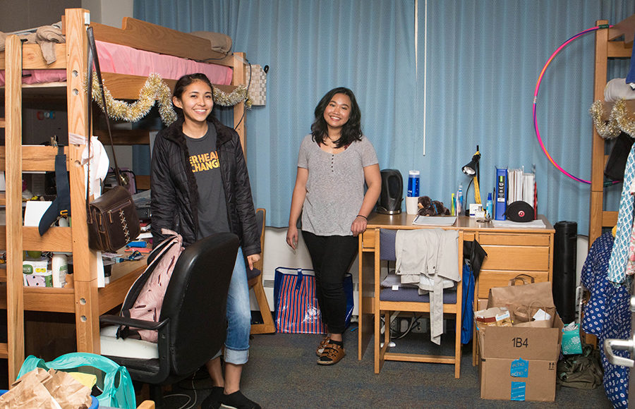 Jessica Mendoza, left, and Gianina Wicaksono are two freshman roommates who live in Unit 1's Freeborn building. Their room was converted from a laundry room into a triple. On occasion, people mistake their room for a bathroom because their room also has a blue door. Sometimes other residents in their building accidentally walk into their room late at night!