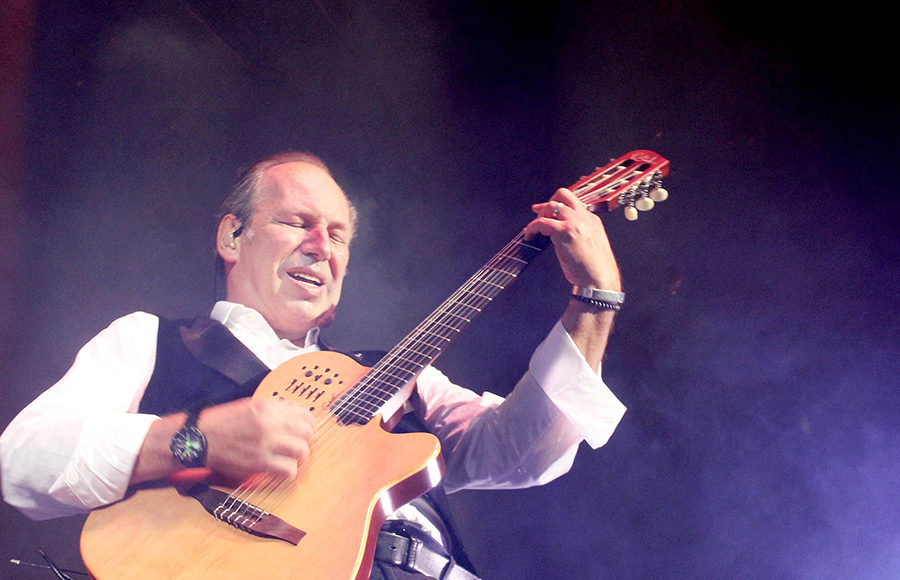 Composer Hans Zimmer plays guitar at one of his live performances.